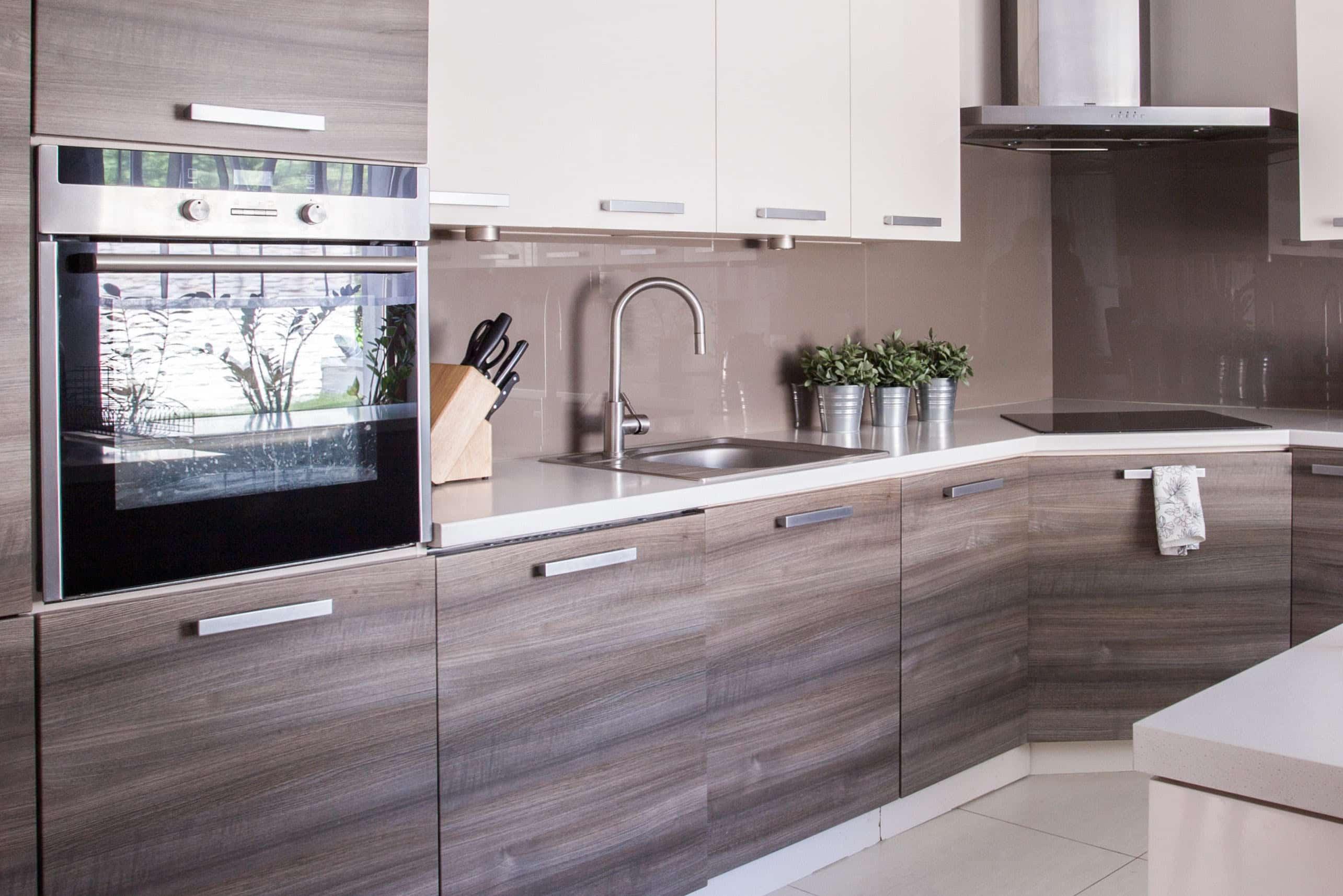 Wooden cupboards in cozy kitchen